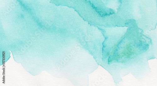 Light turquoise color watercolor illustration, creative background, smeared sky blue shades frame. Aquarelle painted textured canvas for vintage design, invitation card