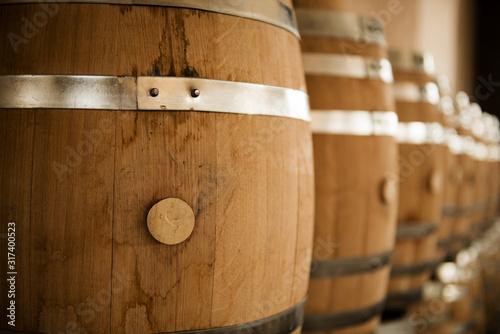 wooden barrels of wine in a cellar