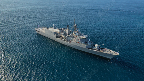 Fotografia Aerial drone photo of Hellenic Navy Frigate Hydra cruising in low speed in Aeg