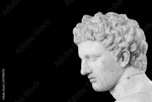 Leinwand Poster Black and white photo showing detail of male head of classical roman statue