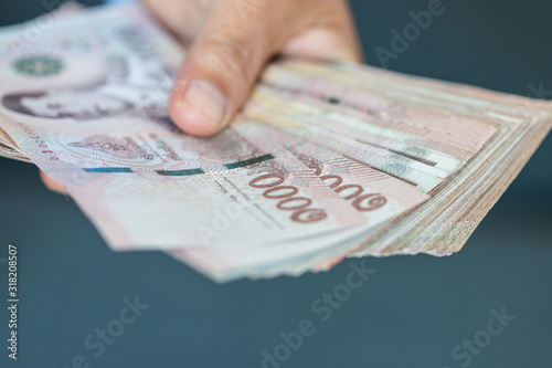 Obraz na plátne Blurred of Stack Thai baht banknotes, one thousand baht with tag text in Thai word