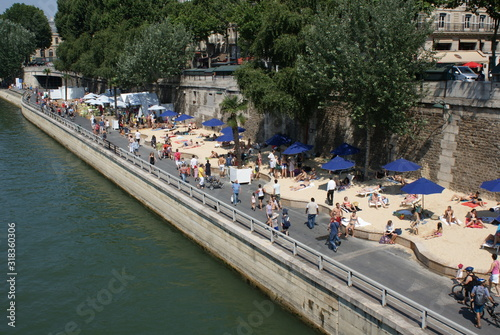 Fotografie, Obraz High Angle View Of People Walking On Street By River