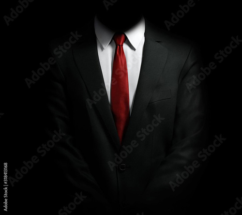 Fotografia Midsection Of Businessman Against Black Background
