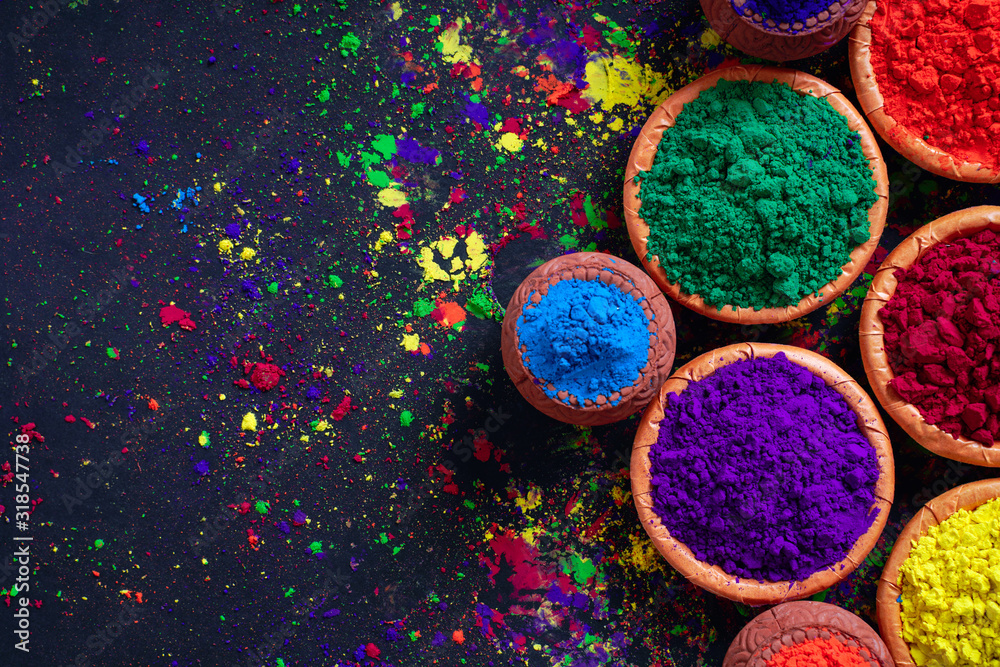 Indian Festival Holi, Colors in wooden bowl on dark background