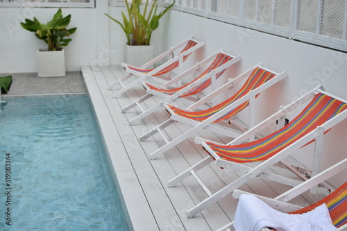 Empty Deck Chairs By Swimming Pool Fototapet