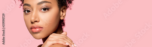 panoramic shot of beautiful african american girl with clean face, isolated on pink