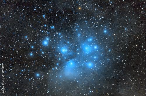 Fotografiet Blue cosmic nebula and blue stars.