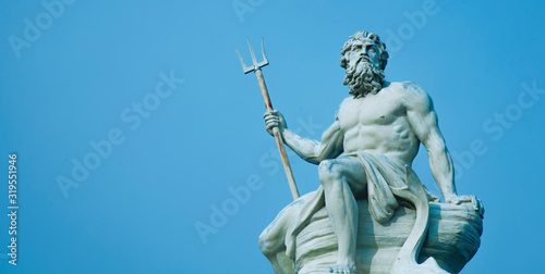 Obraz na płótnie Ancient stone statue of mighty god of the sea and oceans Neptune (Poseidon) with trident