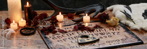Obraz na plátně Mystic ritual with Ouija and candles
