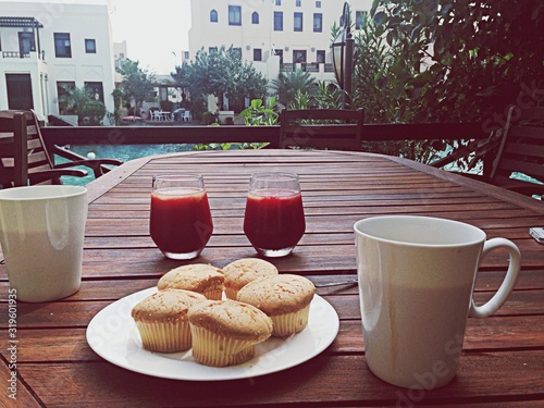 Fototapeta Coffee juice and muffins for two