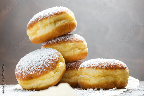 Fotografiet Close-up of donuts (Berlin pancakes) dusted with powdered sugar served on a rust