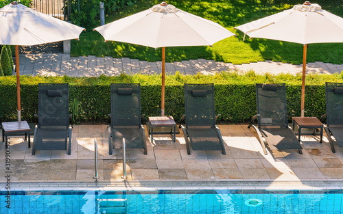 Tablou Canvas Sunbeds at swimming pool at Geneva Lake Montreux Swiss Riviera
