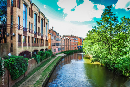 Fotografia Canal Amidst Buildings And Trees In Guildford