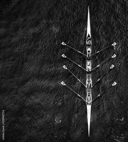 Slika na platnu Directly above shot of people sailing in rowboat on sea