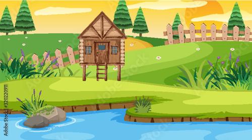 Fotografia, Obraz Scene with wooden cottage in the field