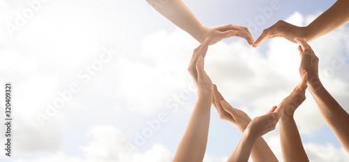 Billede på lærred The concept of unity, cooperation, teamwork and charity.