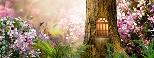 Stampa su Tela Enchanted fairy tale forest with magical shining window in hollow of fantasy pin