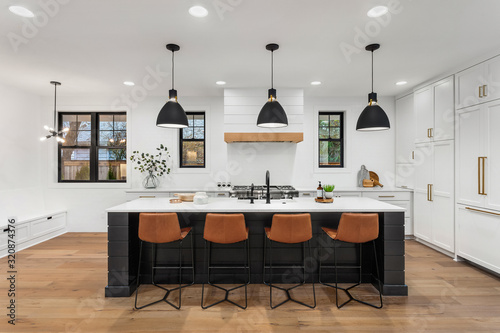 Valokuva Beautiful white kitchen with dark accents in new modern farmhouse style luxury h