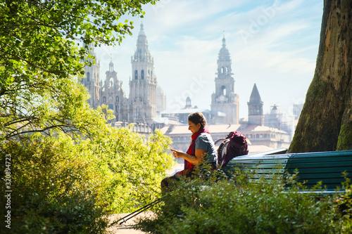 Leinwand Poster Tourist Woman On Pilgrimage At Santiago De Compostela With Phone