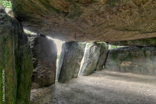 Canvas Print Inside a prehistoric burial chamber or Dolmen La Roche aux Fees