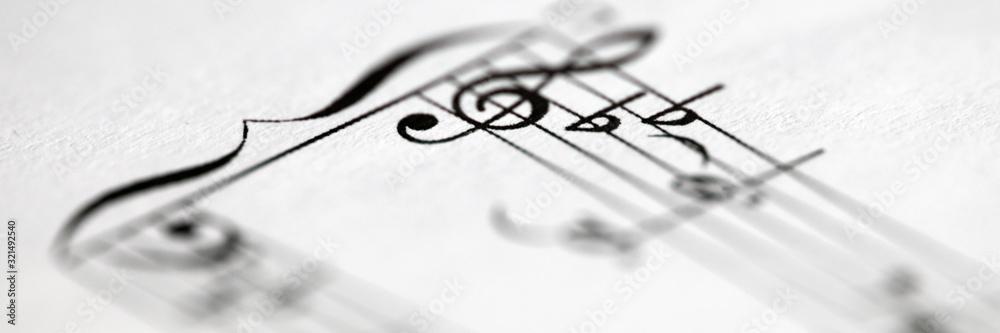 Musical notes printed on paper sheet <span>plik: #321492540 | autor: megaflopp</span>