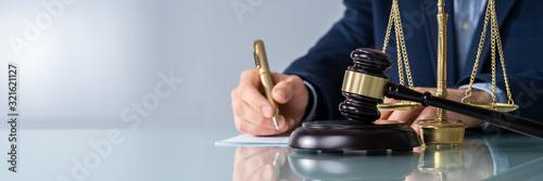 Tableau sur Toile Male Judge Signing Document At Desk