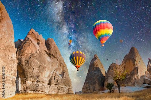 Fotografija Colorful hot air balloons flying over at fairy chimneys in Nevsehir, Goreme, Cappadocia Turkey