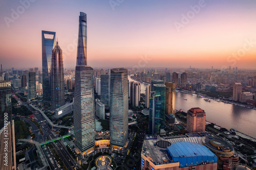 Fotografia illuminated Lujiazui skyline and Ring road circular footbridge, Shanghai, China