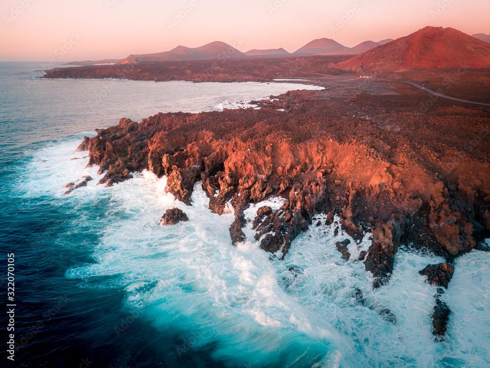 Aerial view of Los Hervideros lava cliffs and ocean. Lanzarote, Canary Islands.