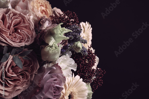 Beautiful bouquet on black background. Floral card design with dark vintage effect