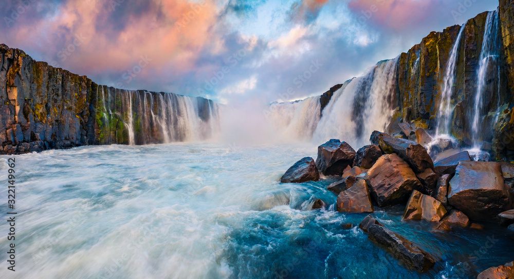 View from the down of canyon of Selfoss Waterfall. Unusual view from flying drone of Jokulsa a Fjollum river, Jokulsargljufur National Park. Colorful sunrise in Iceland, Europe.