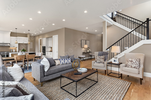 Photo Living room and kitchen interior in new home with open concept floor plan