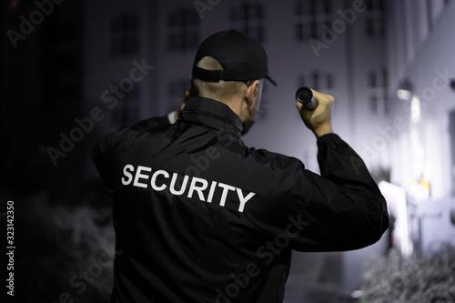 Fotografie, Tablou Security Guard Walking Building Perimeter