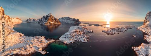 фотография Sunrise on Lofoten island is archipelago with fishing village on coastline in wi