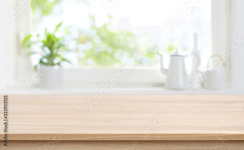 Obraz na płótnie Wooden kitchen table with background of window for product display