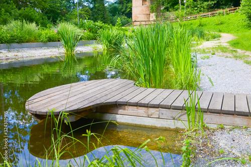 Obraz na plátně Exotic park with terrace and pond