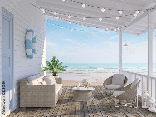 Fényképezés The wooden house terrace on the beach 3d render,Tthere has old wooden floors,white plank walls,blue doors decorated with fabric and rattan furniture, decorated with string lights, overlooking the sea
