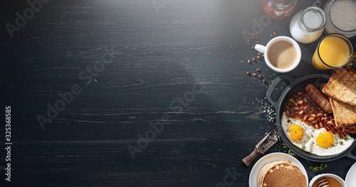 English breakfast on a dark table Fototapeta