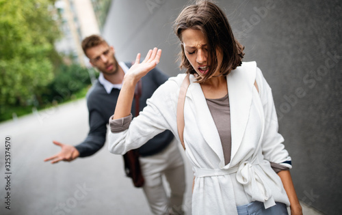 Sad young woman and man outdoor on street having relationship problems Fototapeta