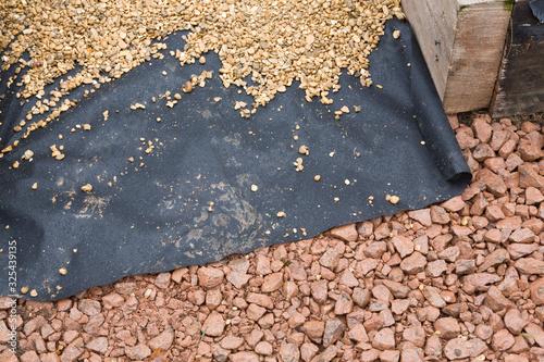 Vászonkép Hard landscaping materials, laying gravel path, UK