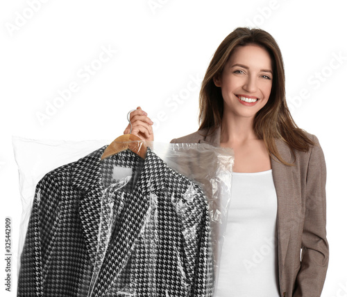 Fotografia, Obraz Young woman holding hanger with jacket in plastic bag on white background