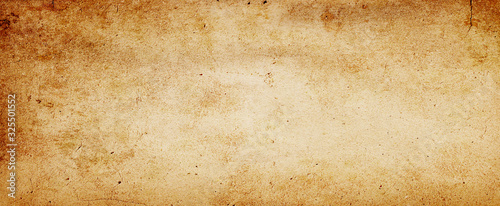 Fotografie, Obraz Old brown paper parchment background design with distressed vintage stains and i