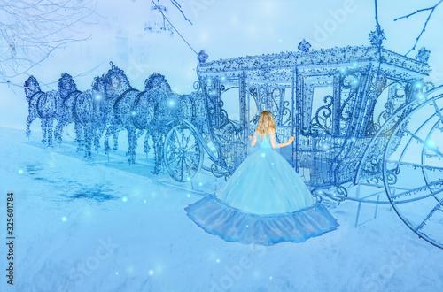 Beautiful princess in blue long dress on the luminous blue carriage background Fototapet