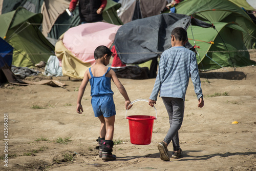 Greece, Idomeni (border with Macedonia), March 22nd 2016: the biggest refugee camp in Europe at that time, hosting up to 11 Fototapeta