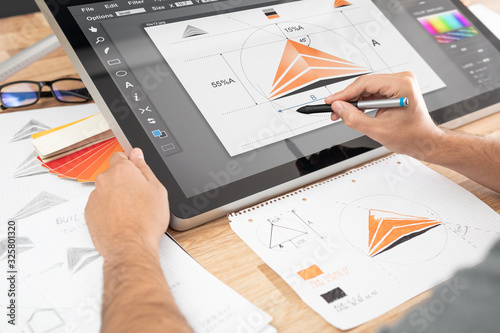 Fotografia Graphic designer drawing sketches logo design.