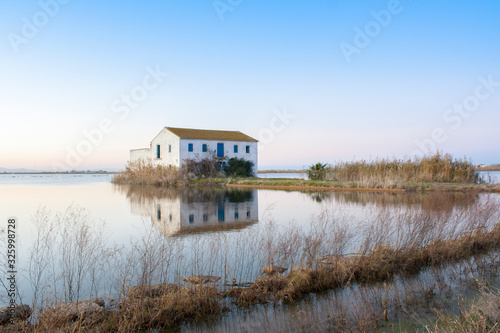 house in the middle of the rice fields of the albufera of valencia