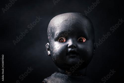 Canvas Print Creepy doll in the dark