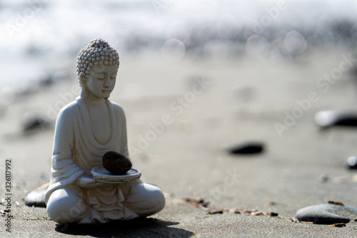 Leinwand Poster buddha statue in calm rest pose
