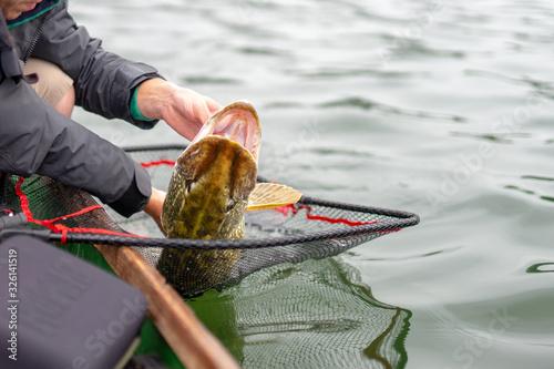 fisherman with fish Fototapete