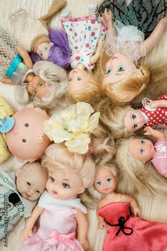 Many old dolls lies on floor in children room Fototapeta